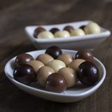 Chocolate balls on wooden table Royalty Free Stock Photo