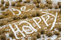 Chocolate balls with the word Happy Stock Photography