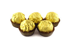 Chocolate balls wraped in the golden package isolated on white Royalty Free Stock Photo