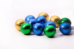 Chocolate balls wrapped in colourful foil. Image of chocolate balls Royalty Free Stock Photos
