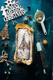 Christmas banana bread flat lay top-down composition. Chocolate banana bread with a christmas tree decor on the top, spatula, sieve and christmas decoration stock image