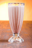 Chocolate banana cocktail on brown board at sunset Stock Photo