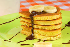 Chocolate and banana heart shaped pancakes Stock Photography