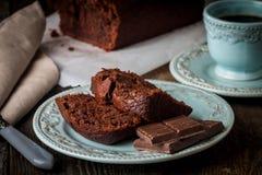 Chocolate-banana Loaf cake on paper Stock Image
