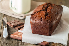 Chocolate-banana Loaf cake on paper Stock Photos