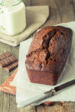 Chocolate-banana Loaf cake on paper Stock Photography