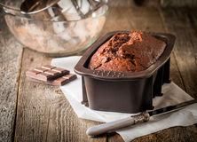 Chocolate-banana Loaf cake on paper Royalty Free Stock Photos