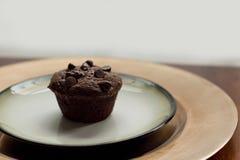 Chocolate Banana Muffin. Single Chocolate Banana Muffin on golden plate Royalty Free Stock Photos