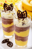 Chocolate and banana pudding on wooden tray. Stock Photo