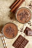 Chocolate banana smoothie with cinnamon.Top view . Royalty Free Stock Images