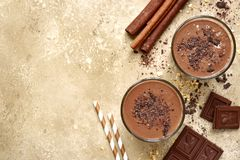 Chocolate banana smoothie with cinnamon.Top view with copy space Royalty Free Stock Photography