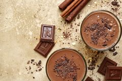 Chocolate banana smoothie with cinnamon.Top view with copy space Royalty Free Stock Images