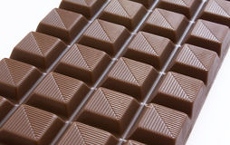 Chocolate Bar. Closeup of chocolate bar isolated over a white background stock photography