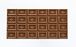 Chocolate bar. Bar of milky chocolate on white background Royalty Free Stock Photography