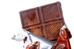 Chocolate bar. Fresh chocolate bar with cover on white background Royalty Free Stock Image