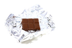 Chocolate bar. Bar of chocolate in foil on a white background Stock Photo
