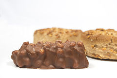 Chocolate bar with almonds in front of several Christmas sweets Stock Photos