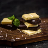 Chocolate bar. Black and white chocolate. Black and white chocolate and fresh mint Stock Photography