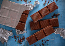 The chocolate bar. On blue wood table Royalty Free Stock Photography