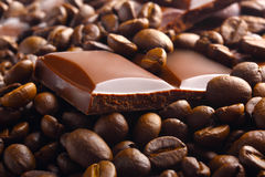 Chocolate bar in coffee beans Stock Images