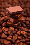 Chocolate bar on coffee beans Stock Photography