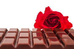 Chocolate bar and dark red rose Stock Images