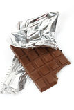Chocolate bar in foil Stock Images