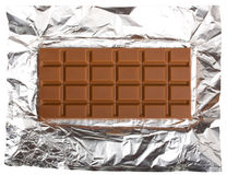Chocolate bar on foil. Isolated on white background Stock Photos