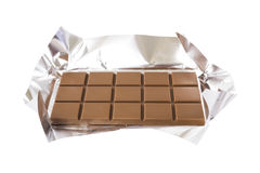Chocolate bar with foil Royalty Free Stock Photography