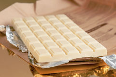 Chocolate bar on gold base and silver Royalty Free Stock Photos