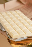 Chocolate bar on gold base and silver Royalty Free Stock Photography