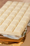 Chocolate bar on gold base and silver Royalty Free Stock Image