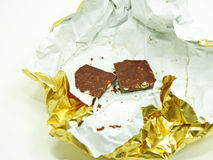 Chocolate bar in golden foil. royalty free stock photography