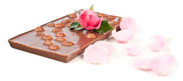 Chocolate bar, a rose and rose petals Stock Image