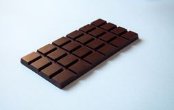 A chocolate bar  on white background from the side view royalty free stock image