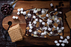 Chocolate bar with marshmallows. Graham crackers and milk chocolate pieces Stock Photos