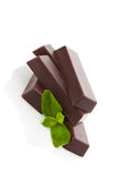 Chocolate bar with mint. Royalty Free Stock Photography