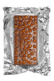 Chocolate bar with nuts in aluminum foil Stock Photography