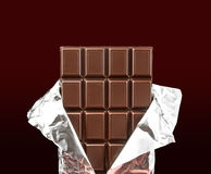 Chocolate bar with open cover Stock Photography