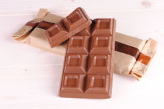 Chocolate bar and a packet Royalty Free Stock Photos