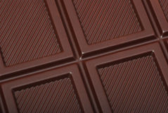 Chocolate bar pieces background Stock Photo