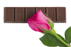 A chocolate bar with a pink rose flower Royalty Free Stock Photos