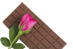 A chocolate bar with a pink rose flower Stock Photography
