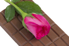 A chocolate bar with a pink rose flower Stock Image