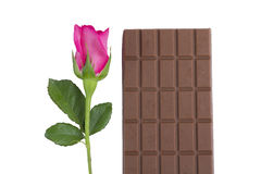 A chocolate bar with a pink rose flower Royalty Free Stock Image