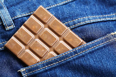 Chocolate bar in the pocket Royalty Free Stock Image