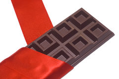 Chocolate bar and red silk Royalty Free Stock Photography
