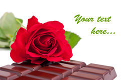 Chocolate bar and rose Royalty Free Stock Image