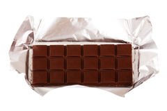 Chocolate bar in silver foil. Isolated on white background Royalty Free Stock Photo