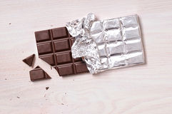 Chocolate bar with silver wrapping top view Royalty Free Stock Images